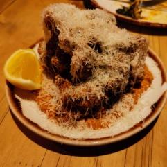 Fried buttermilk spiced chicken, grated Graviera cheese and Muhammara