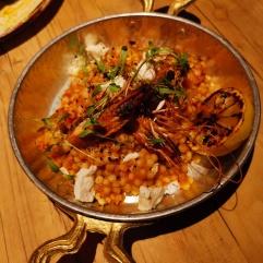 Tiger prawns with ouzo Saganaki fregola and burnt lemon